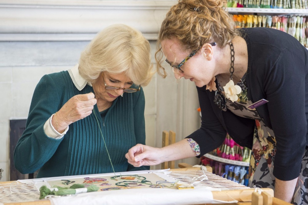 The-Duchess-of-Cornwall-is-taught-hand-embroidery-by-the-Royal-School-of-Ne