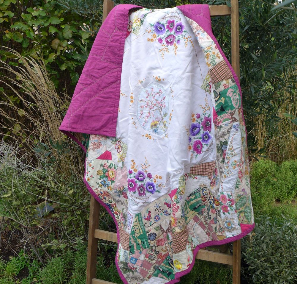 Handmade crazy patchwork quilt with vintage fabrics and linen
