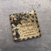 Pride & Prejudice Gold Peacock Coaster
