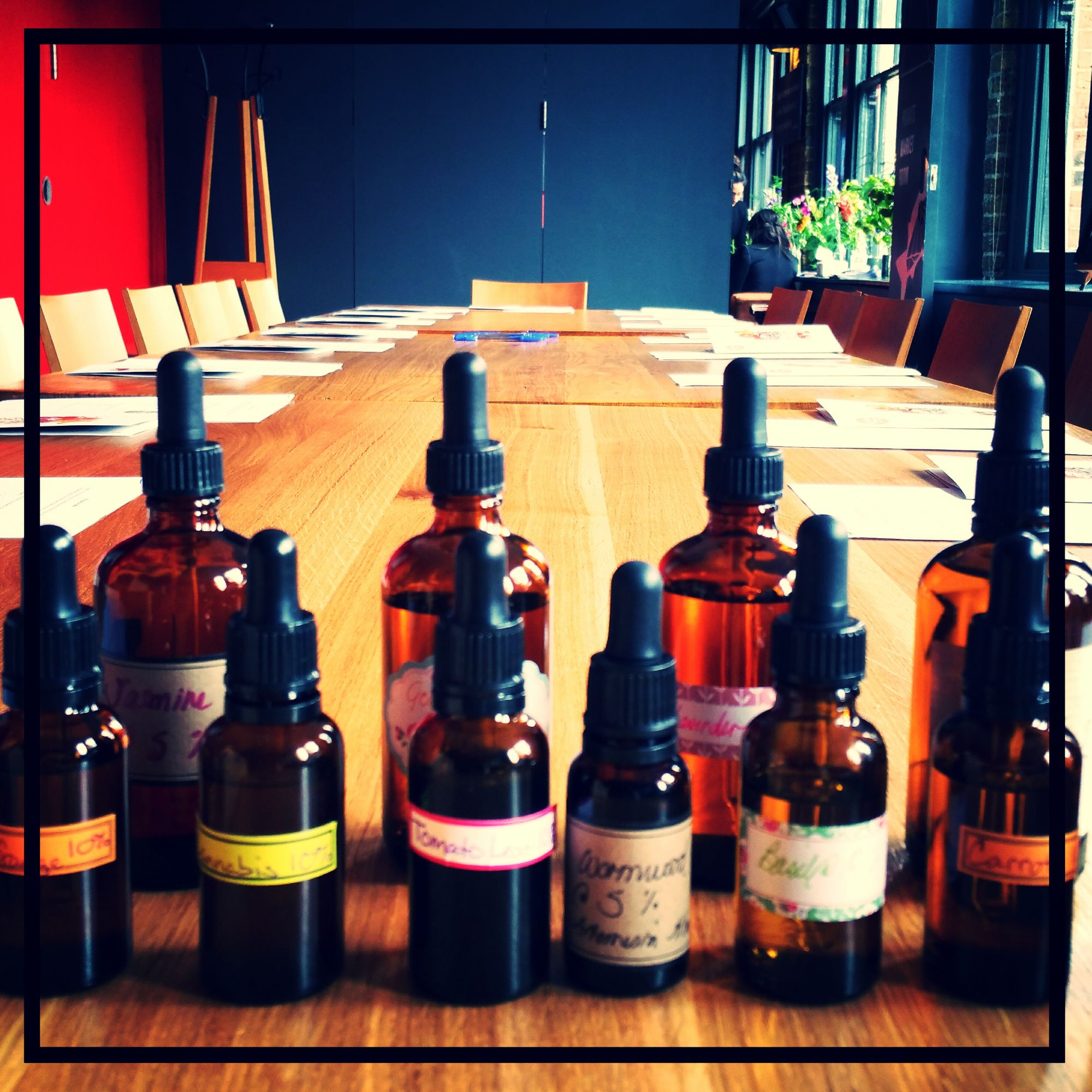 a line up of bottles of ingredients ready for a perfume event