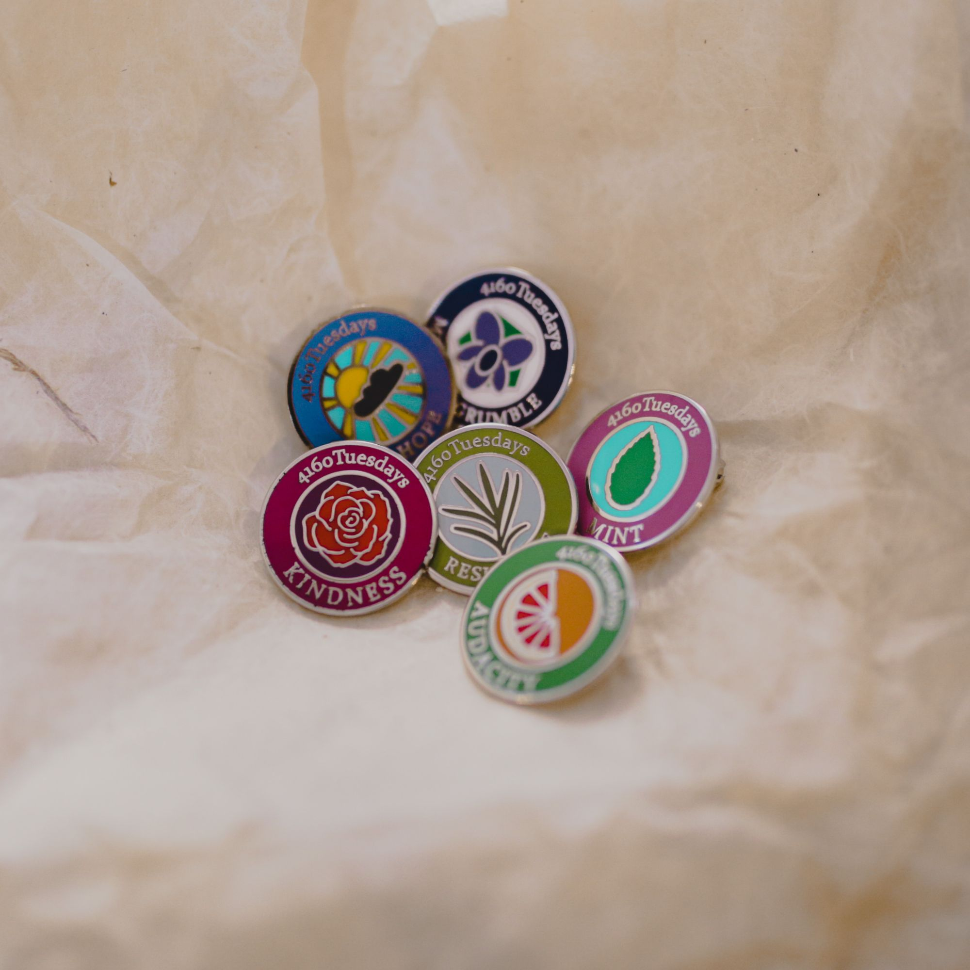 A selection of 6 4160 Tuesdays badges
