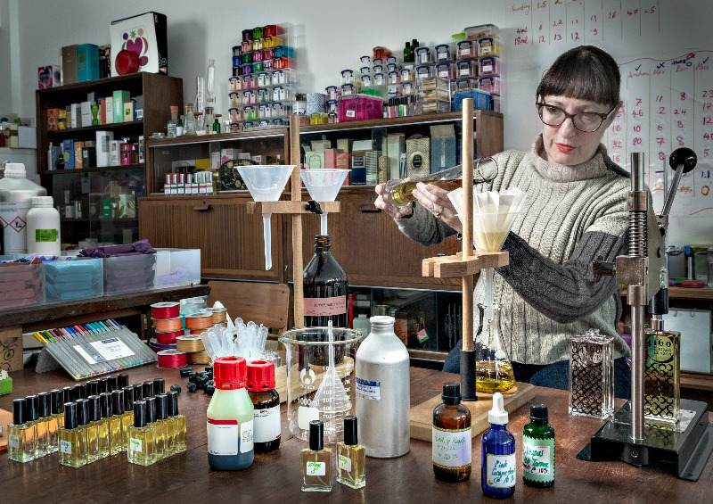 Sarah making perfume in the studio
