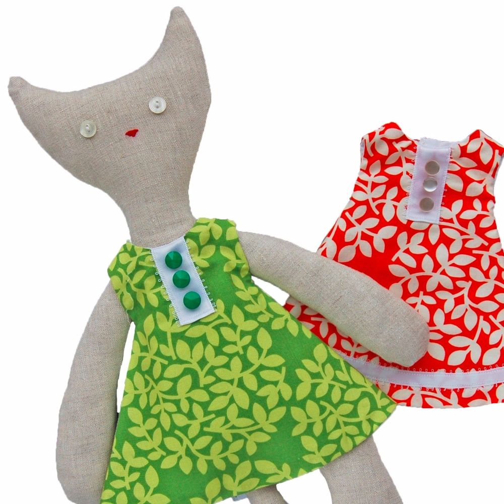 Cat with Green and Orange Dresses