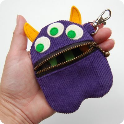 monsterpursepurplehandrounded400