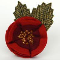 front page brooch red rose