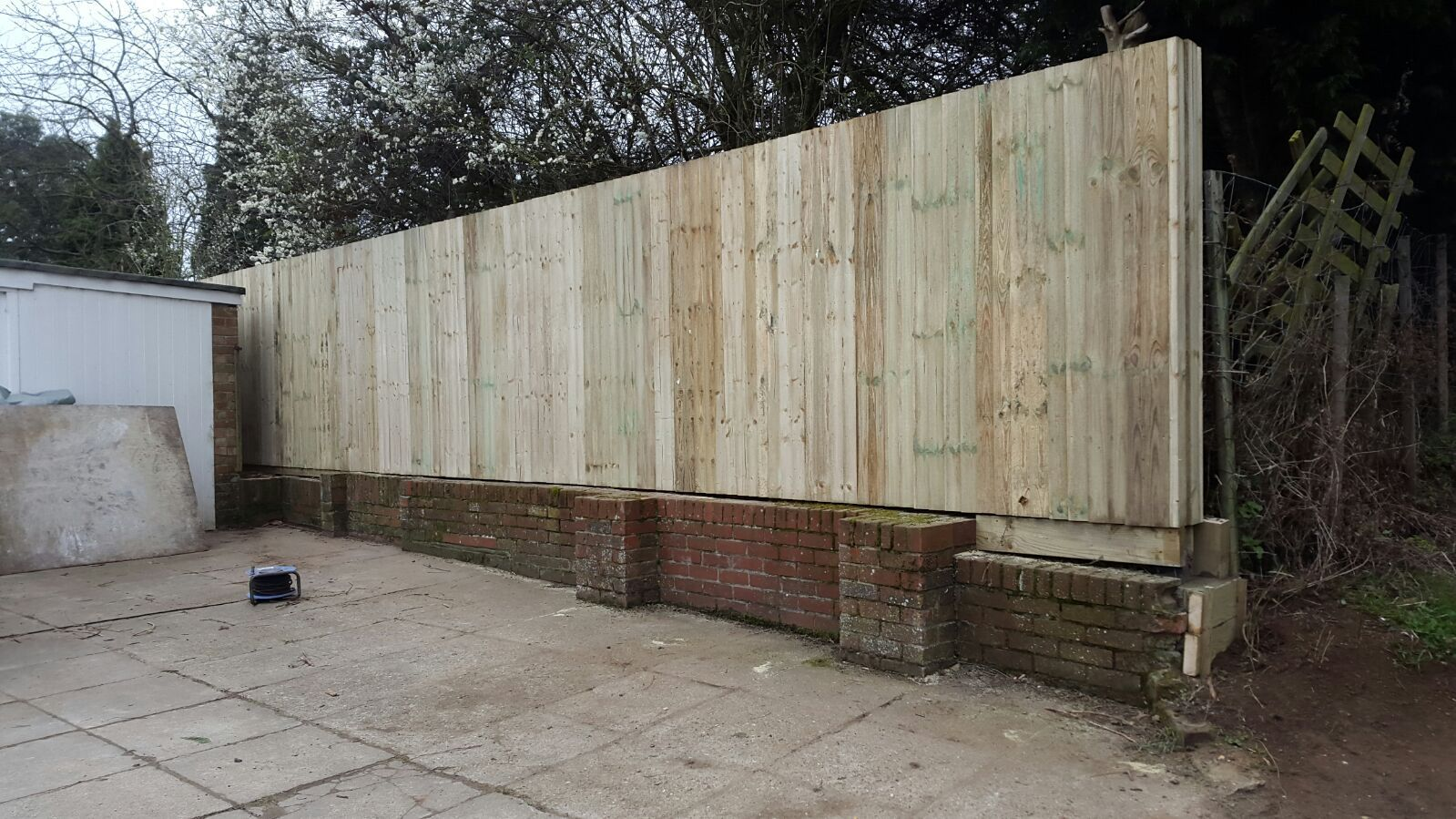Closeboard fence on top of a wall (3)