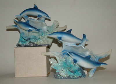 double dolphin with conchie shell