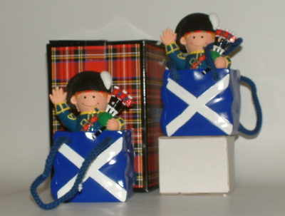 EL805 Scotsman piper money box