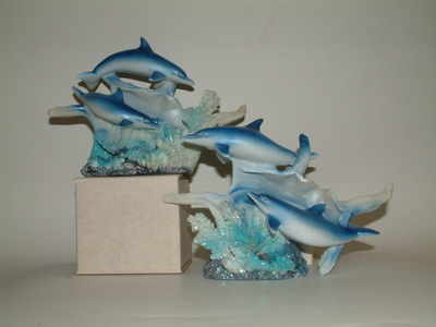 AM8025 Double dolphins on conchie shell