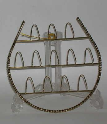Horseshoe thimble rack
