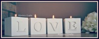 White wooden blocks with candle