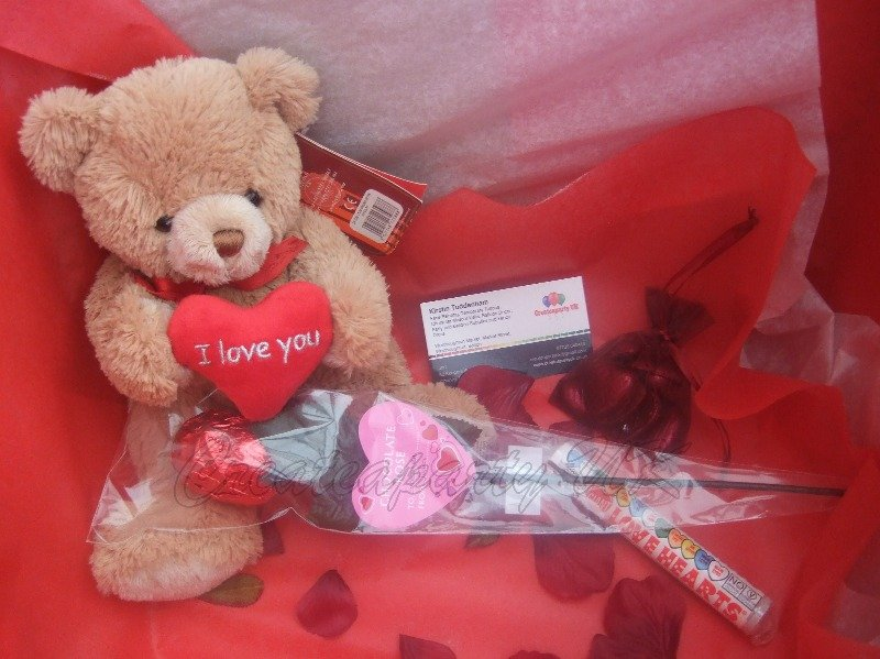 inside balloon in a box with i love you bear