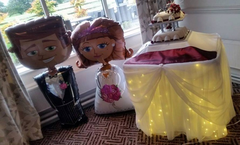 A bride and groom with starlight cake skirt