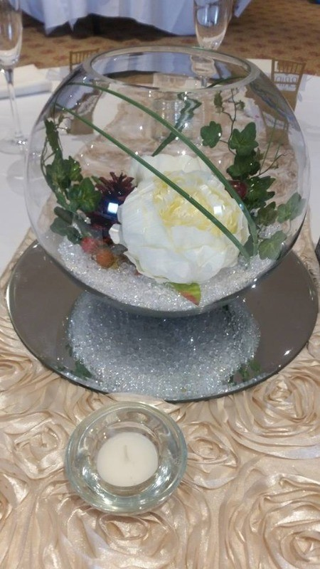 fish bowl with peonies and autumn cones etc