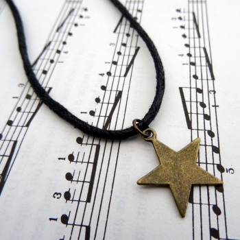 Bronze star charm necklace on black cord MN023