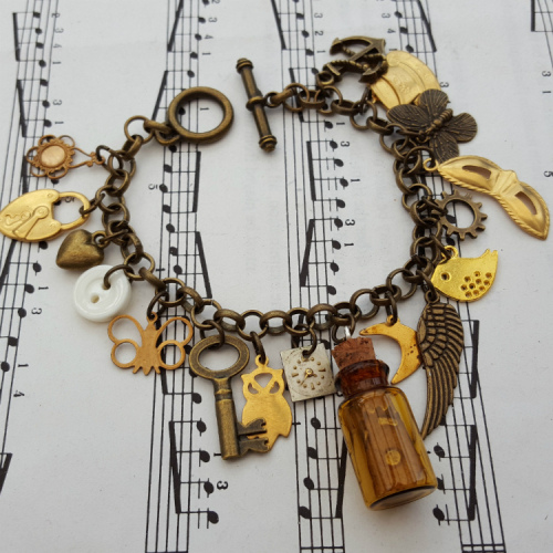 Statement assemblage vintage bronze and brass charm bracelet VCB028