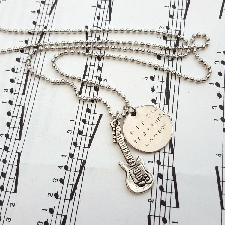 Bass guitar and Pirate Treasures disc necklace on ball chain MN030