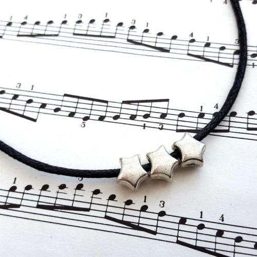 Three silver stars necklace on black cord CN100