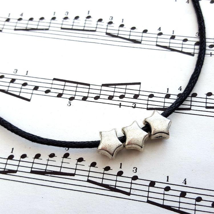 Three silver stars necklace on black cord CN100