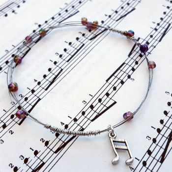 Guitar string bracelet with purple beads & music note charm GSB009