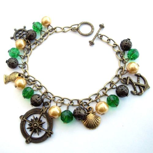 Nautical pirate charm bracelet, green and gold beads and antique bronze cha