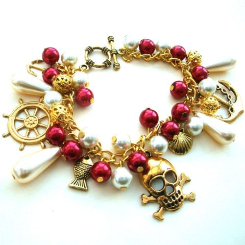 Pirate charm bracelet in gold, red & cream PCB105