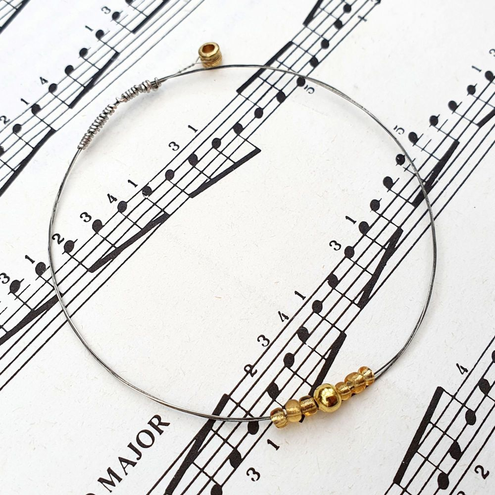 Guitar string bracelet with gold beads & optional music note charm GSB024