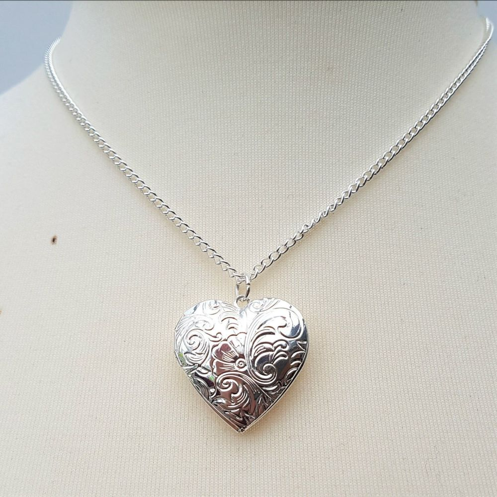 Silver heart locket necklace with vintage style floral design
