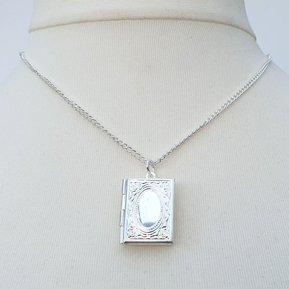 Silver book locket with personalised message