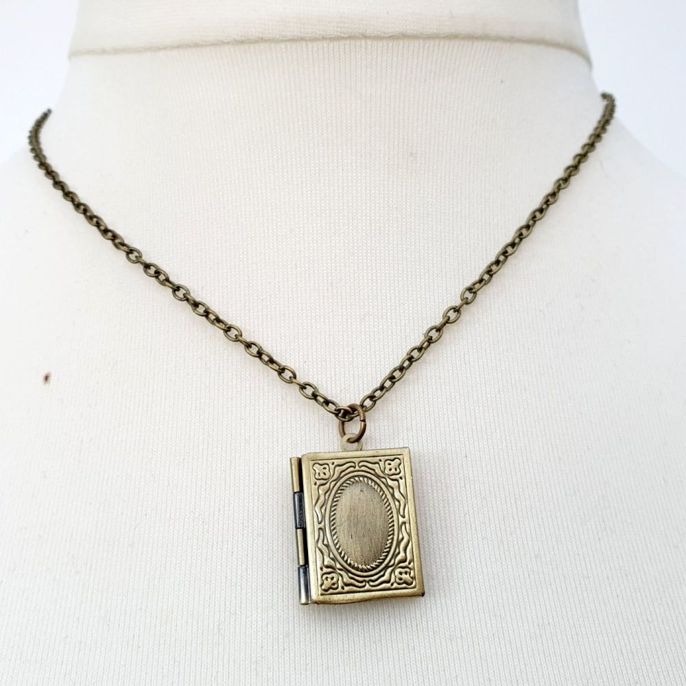 Antique bronze book locket with personalised message