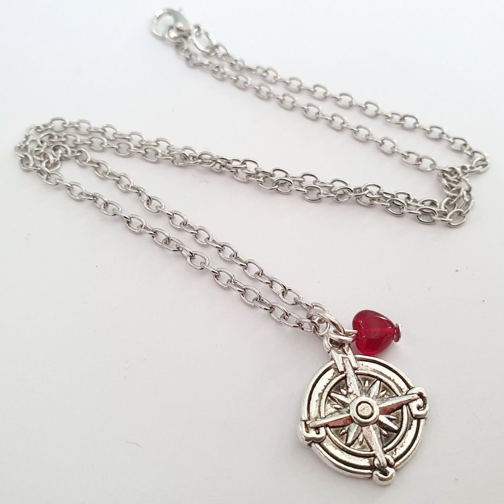 Silver compass and red heart charm necklace