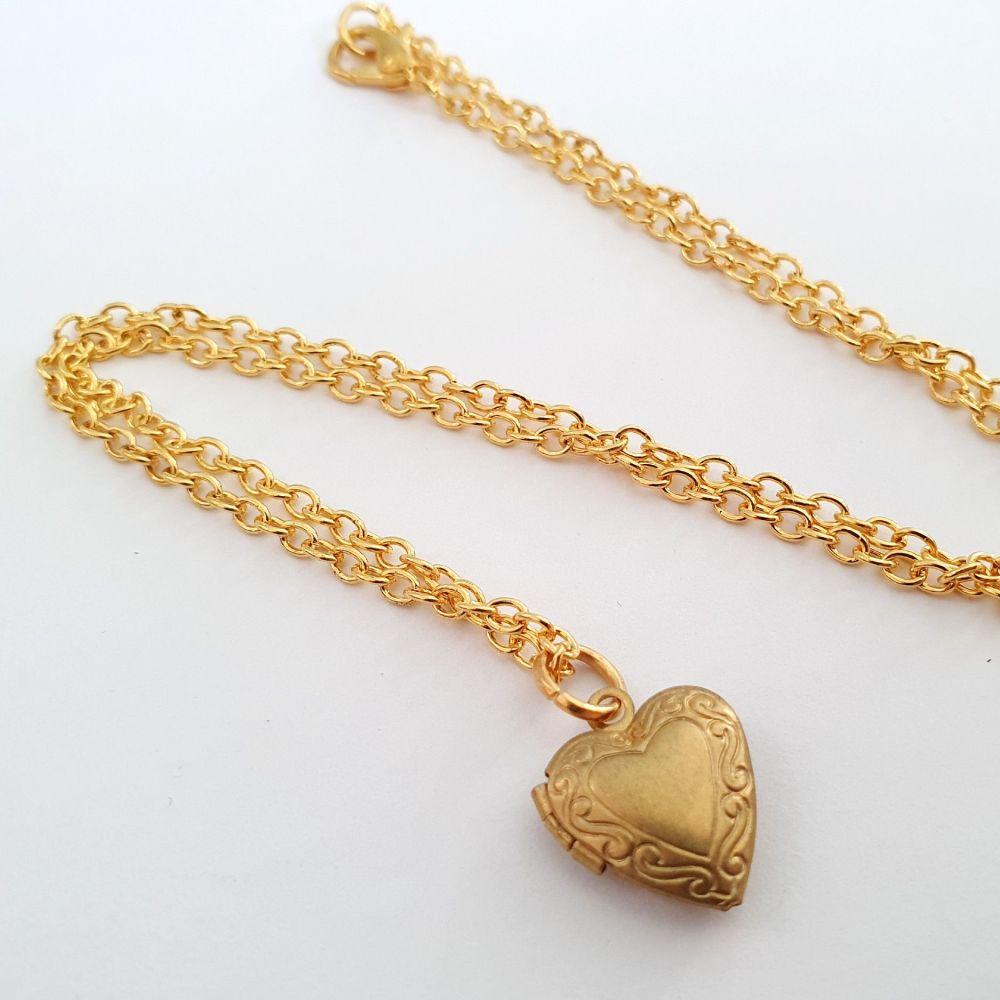 Tiny brass heart shaped locket necklace