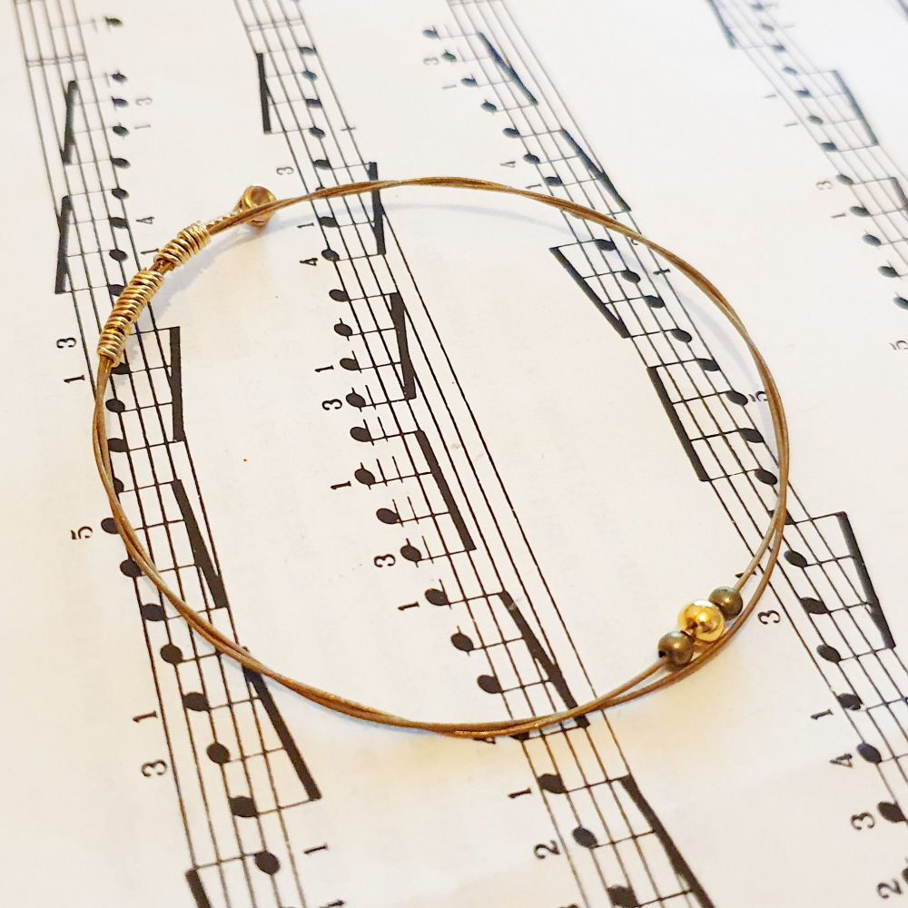 Acoustic guitar string bracelet with gold & bronze beads GSB026