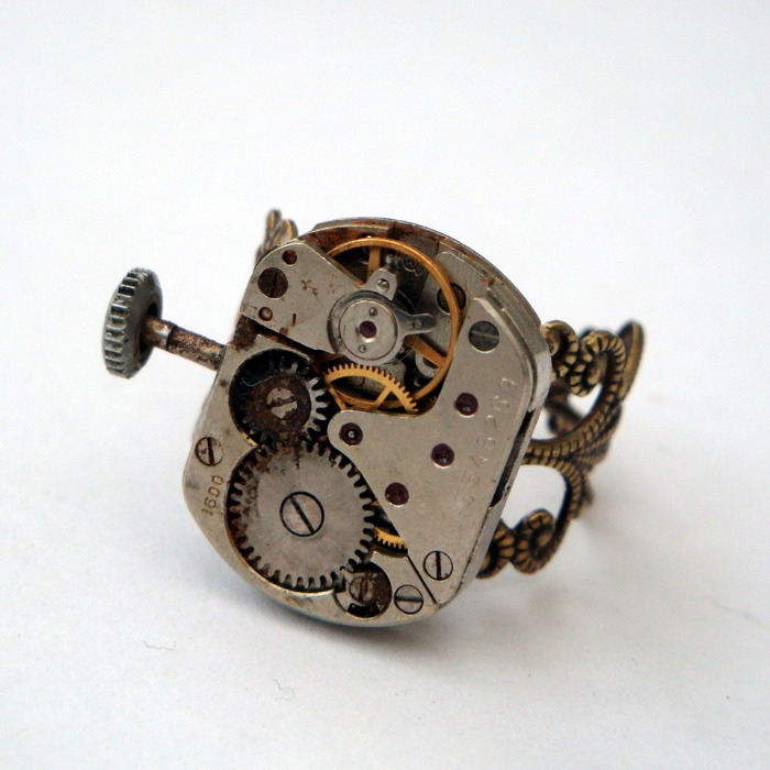 Steampunk ring with watch movement on bronze filigree base SR055