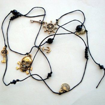 PN106 Black & gold knotted pirate charm necklace