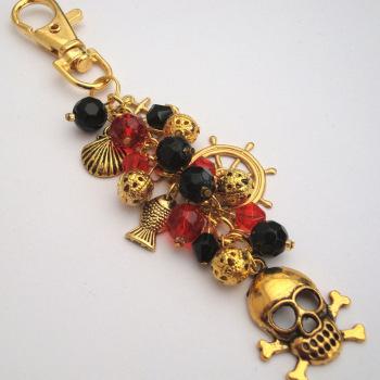 PBG039 Gold, Red & black pirate bag charm
