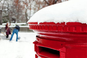 Red post box in the snow last recommended posting dates for christmas