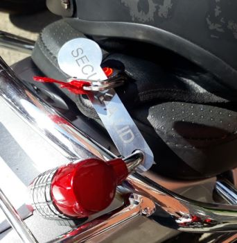 Motorcycle open face helmet lock with a quick release buckle fastener