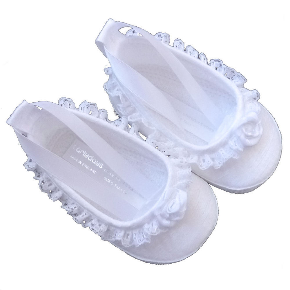 White baby pram shoes with lace edging
