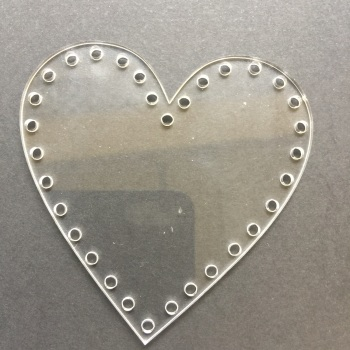 Acrylic lasercut form with holes for decorating heart