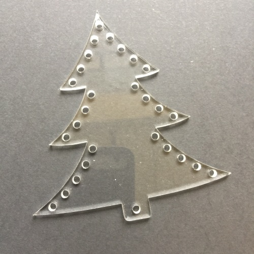 Acrylic lasercut form with holes for decorating tree