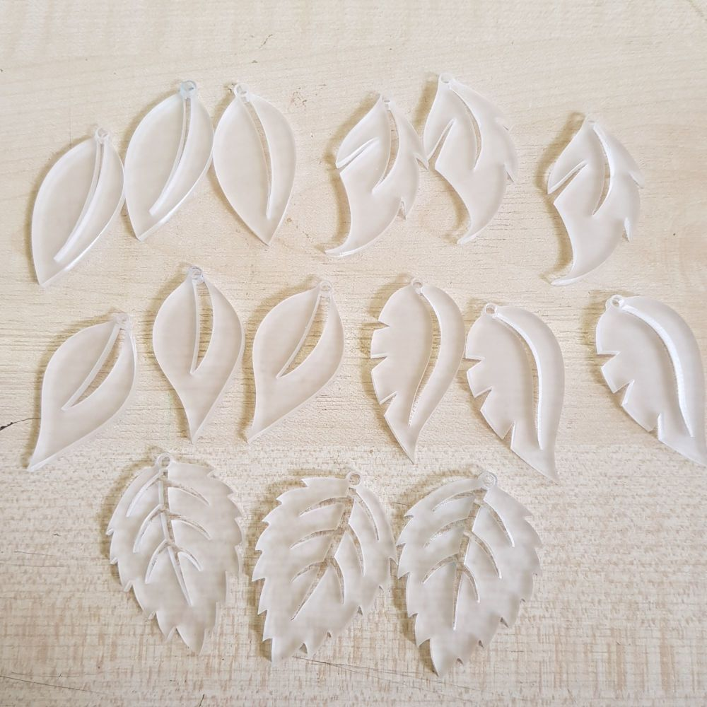Perspex pendants frosted white leaves
