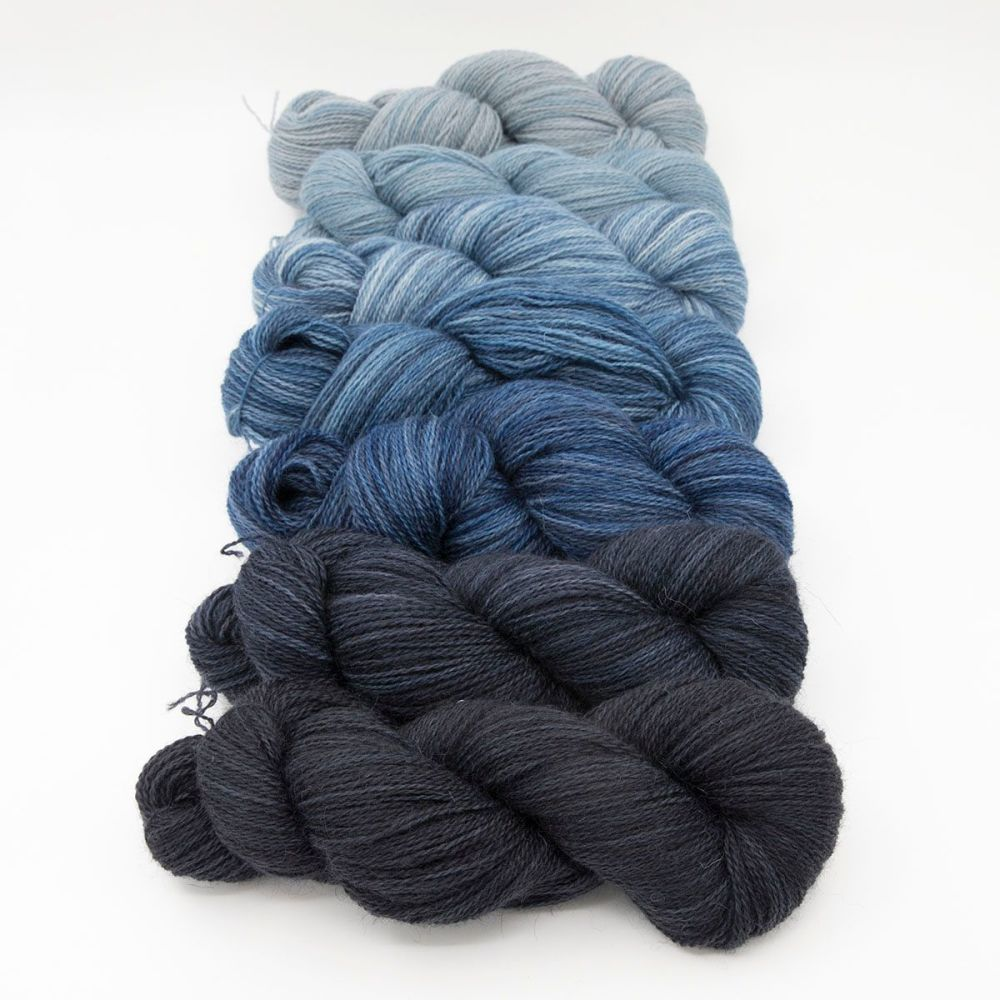 dark blue and superhero genes skeins one farm yarn 4ply hand dyed british