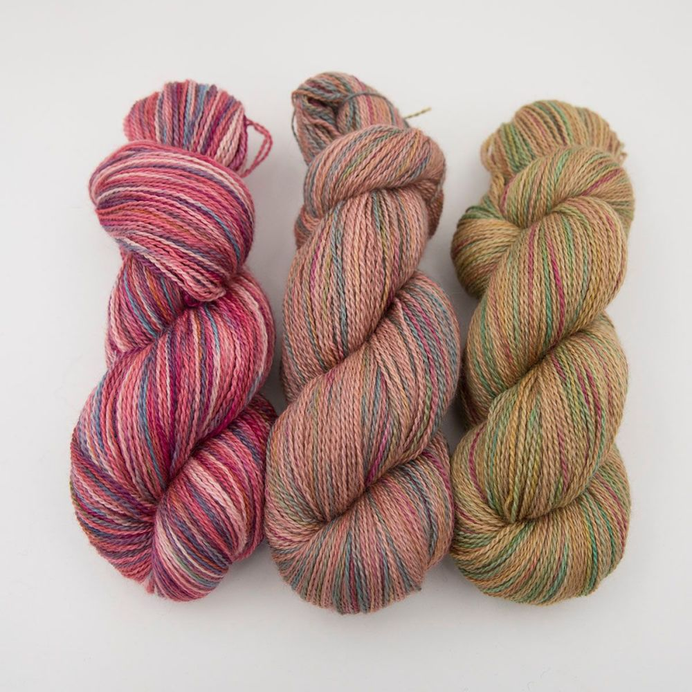 red orange gold rainbow splodge yarn blue faced leicester silk alpaca luxu