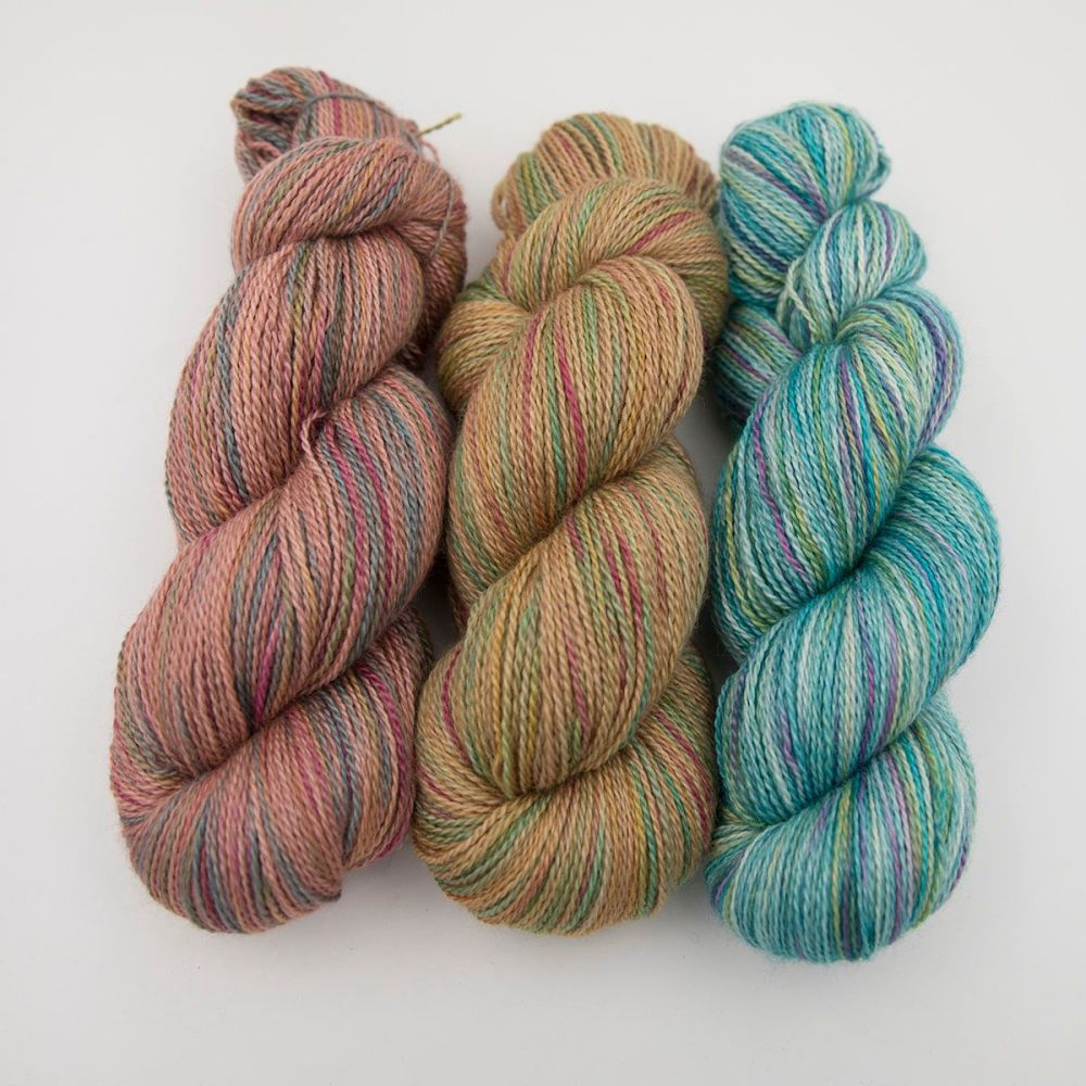 orange gold green rainbow splodge yarn blue faced leicester silk alpaca lu