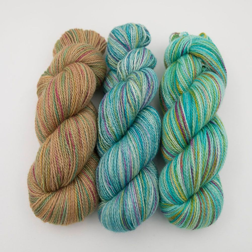gold green turquoise rainbow splodge yarn blue faced leicester silk alpaca