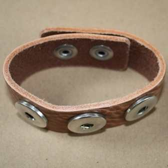 A brown leather bracelet for poppers