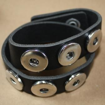 A double black leather bracelet for poppers