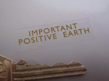 "Positive Earth Gold on Clear Sticker. 1.75""."
