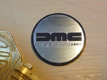 DeLorean Logo Style Self Adhesive Laser Car Badge. 25mm.
